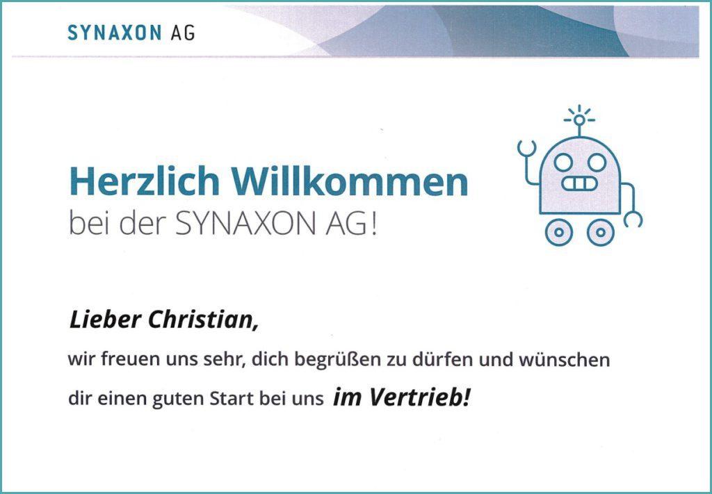 Karriereweg - Christian Frese - Begrüßungsschild. Bild: SYNAXON AG